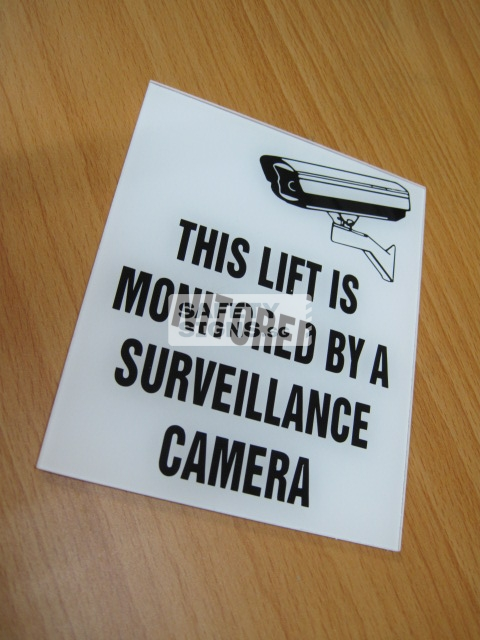 THIS LIFT IS MONITORED BY SURVEILLANCE CAMERAS. Acrylic - Suitable for indoor use.